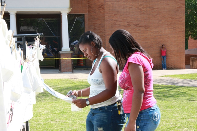 Students Looking at Clothesline