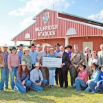 Therral and Jan Story, center, present a check for $2 million to Dr. David Rankin, the SAU rodeo team, and other administrators.