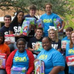 SAU PBL members pose with diapers collected during the Every Little Bottoms Diaper Drive.