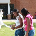 SAU students view the Clothesline Project during its 2010 exhibit.
