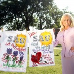 Ceil Bridges, director of alumni relations, stands with three shirts she designed in honor of Julie Hartsfield and her daughter and granddaughter, Dana and Autumn. The shirts were part of the Clothesline Project, a traveling exhibit that raises awareness for domestic abuse. The exhibit was recently on display on the SAU Mall as part of Domestic Violence Awareness month.