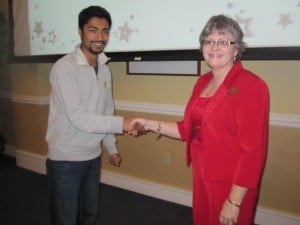 Nishan Shrestha, SI Leader for Dr. Bachri's physics classes, is awarded the fourth SI Scholarship in honor of Dr. Robert Terry by SI Coordinator, Lavana Kindle, for the Spring 2013 semester.