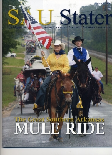 The Great SAU Muleride of 2009 retraces the route of the original 1912 Muleriders. Left to right: the 2009 Mulerider Sunny Wilcox on Molly B and Dr. David F. Rankin, SAU President , lead the mile-long procession of riders. photo