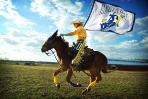 The SAU Mulerider at the school's centennial in 2009, Sunny Wilcox riding Molly B. Photo by Aaron Street. SAU Communications Center photo