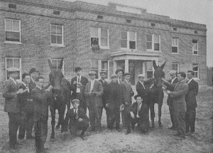 A stock-judging team 1911 with mules. Marvin Williams is at far right. Hainan Holtzclaw kneels at right. The building is Jackson Hall. photo
