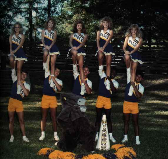 Mulerider mascot in costume with cheerleaders. photo