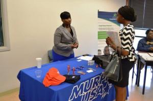 Murphy USA representative meeting with student during Fall 2013 Career Fair