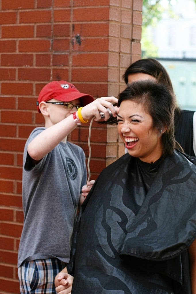 Elijah helps shave Aranda's head