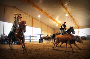 Members of the SAU rodeo team practice roping in the new Story Arena