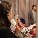 """A theatre student, left, gives voice to a """"patient"""" during an exercise to help prepare nursing students for hospital experiences."""