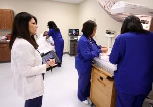 SAU Nursing Bridget Sanders grades students in sim lab