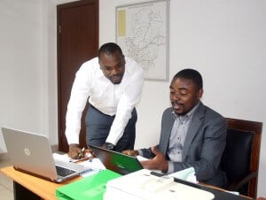 Glenn Muffih with collegue at CHAI in Cameroon